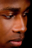 Young african man with dark skin looking Stock Images