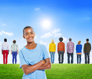Young African Man With Group of Diverse People Stock Photo