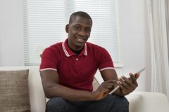Young African Man Holding Digital Tablet Royalty Free Stock Photography