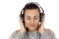 Young african man listens relaxed to mp3 music. Young dark coloured man listens relaxed to mp3 music.Isolated on white background Royalty Free Stock Photos