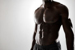 Young african man with muscular body Stock Images
