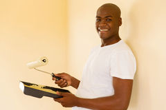 Young african man painting new home Royalty Free Stock Photo