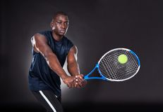 Young african man playing tennis Stock Photography