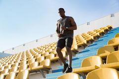 Young african man runner in sport clothes running downstairs a Royalty Free Stock Photography