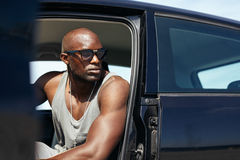 Young african man sitting in car looking away Stock Images