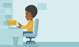Young african man sitting infront of a computer Royalty Free Stock Photo