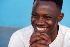 Young african man smiling with hands in chin Royalty Free Stock Image