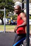 Young african man standing at exercise area outdoors. Portrait of young african man standing at exercise area outdoors at the park Royalty Free Stock Photos