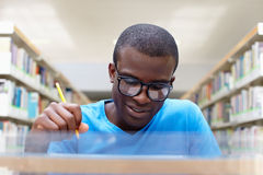 Young African Man Studying In Library Royalty Free Stock Photos