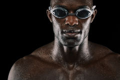 Young african man with swimming goggles Royalty Free Stock Photography