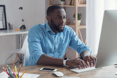 Young african man working in the office business Royalty Free Stock Image
