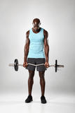 Young african man working out with barbell Stock Photo
