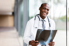 Young african medical doctor. Portrait young african medical doctor holding patient's x-ray royalty free stock photos