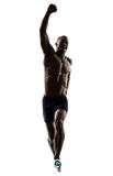 Young african muscular build man jumping running  silhouette Stock Photography