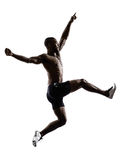 Young african muscular build man jumping running  silhouette Royalty Free Stock Images