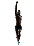 Young african muscular build man jumping running  silhouette Royalty Free Stock Photo