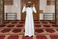 Young African Muslim Guy Praying Stock Photo