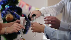 Young african office worker squibs petard with confetti while group of young people is celebrating christmas and new. Year in the office drinking sparkling wine stock video