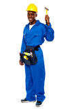 Young african repairman holding hammer royalty free stock photo