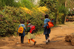 Young African Schoolgirls Walking Home from School. Three young African schoolgirls walking home from school in Suye, Tanzania royalty free stock image