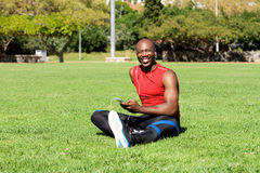 Young african sports man taking break from workout Royalty Free Stock Photography