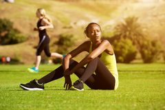 Young african sports woman relaxing after workout Stock Photo