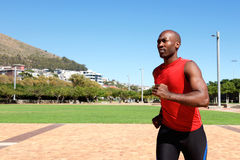 Young african sportsman running outside at the park Stock Photography