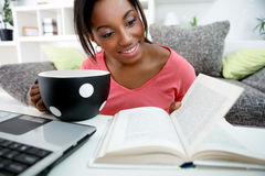 Young African student learning at home Stock Images