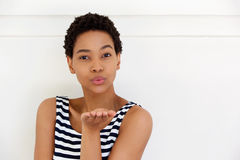 Young african woman blowing a kiss Royalty Free Stock Photography
