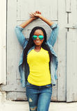 Young african woman in colorful clothes and sunglasses Stock Image