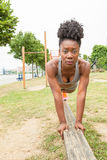 Young African woman doing pushups Stock Images