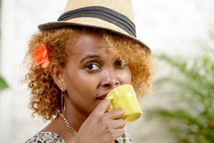 A young African woman drinking coffee Stock Photos