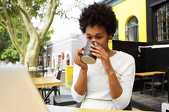 Young african woman drinking cup of tea Stock Photos