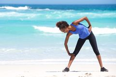 Young african woman exercising on the beach Royalty Free Stock Photo