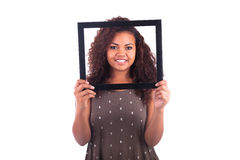 Young African Woman with a frame around her face isolated over a Royalty Free Stock Images