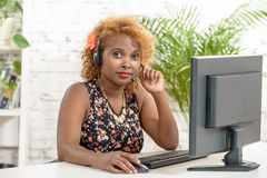 Young African woman with a headset Stock Photo