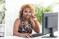 Young African woman with a headset Royalty Free Stock Image