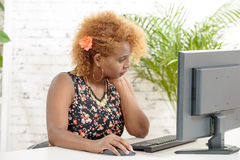 A young African woman and his computer Royalty Free Stock Photo