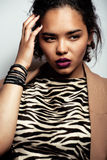 Young african woman. In jacket with zebra print Stock Images