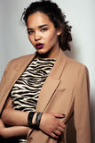 Young african woman. In jacket with zebra print Stock Photo