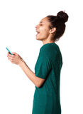Young african woman laughing with mobile phone Royalty Free Stock Image