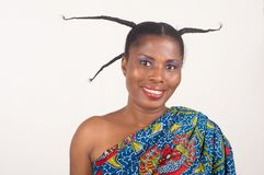 Young african woman with long braids. Portrait of young smiling african woman with long braids on her head looking at the camera Royalty Free Stock Photos