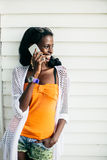 Young african woman with mobile phone Stock Photos