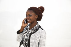 Young African woman on mobile phone Royalty Free Stock Image
