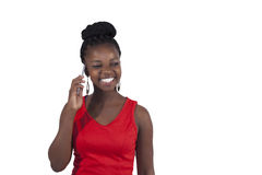 Young African woman on mobile phone Stock Images