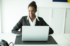 Young african woman in office Stock Images