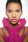 Young African woman in pink gloves Royalty Free Stock Photo