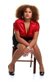 Young african woman posed on a chair Royalty Free Stock Photos