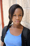 Young African woman posed next to wall. Young African posed next to a brick wall Royalty Free Stock Photos