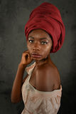 Young African Woman With Red Turban Stock Image